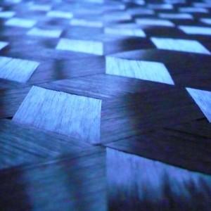 Spread tow triaxial carbon fiber fabric